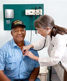 nurse checking heart rate
