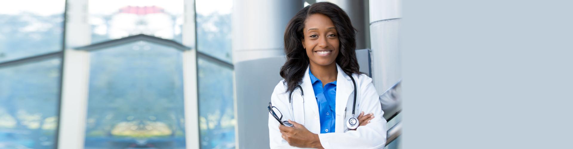 Closeup headshot portrait of female healthcare professional with lab coat